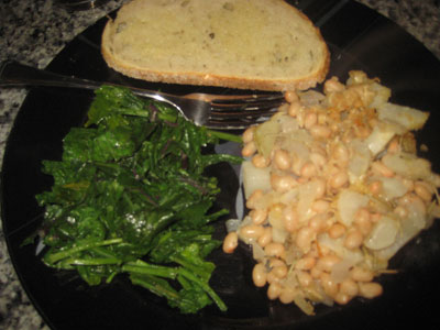 White Bean and Root Vegetable Gratin, plus sauteed greens and bread.